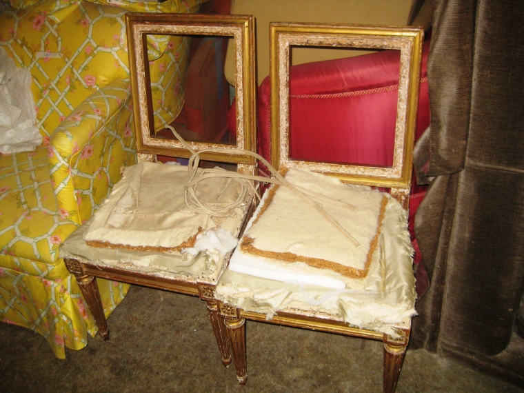 Two authentic antique French chairs ready for reupholstery.
